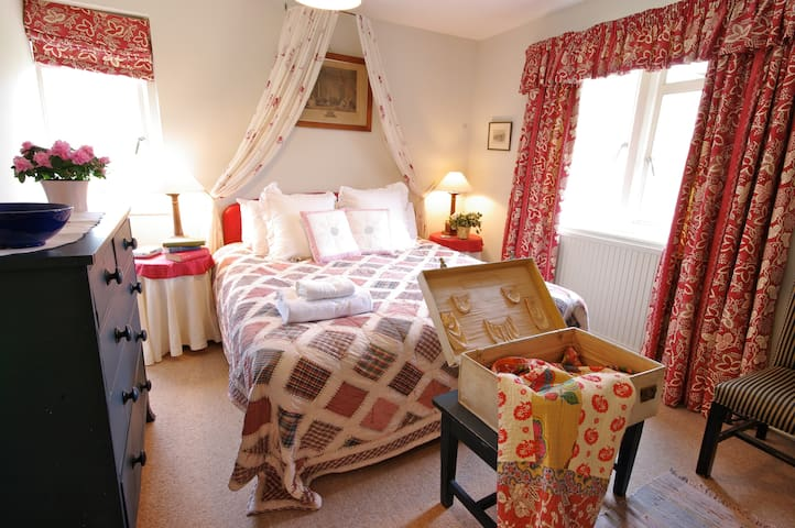 The main bedroom of Over Court looks south over the Owlpen valley
