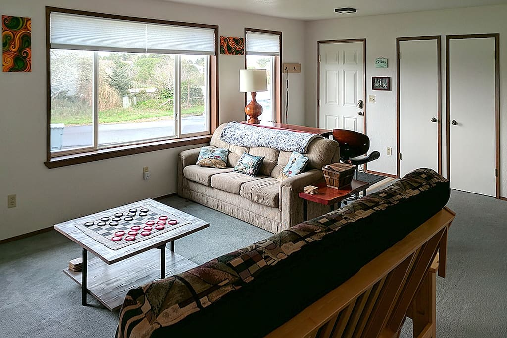 Comfortable living room with game table, futon and hide-a-bed
