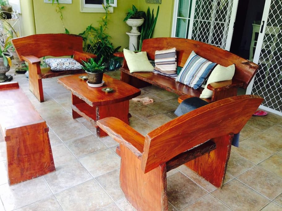 Lanai area with real wood furniture facing the garden.