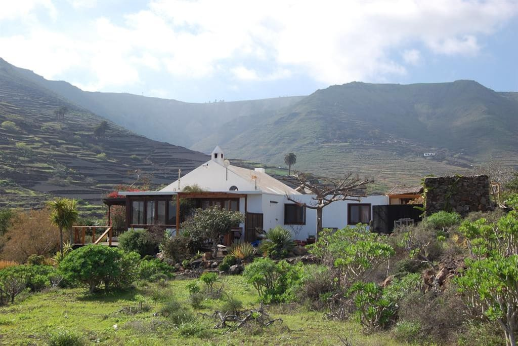 The house with the valley in the background