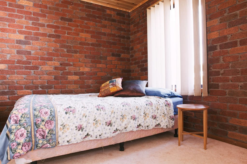 Your room, with comfy Queen bed, portable heater and loads of natural light.  Bedrooms have since been renovated - photos to come)