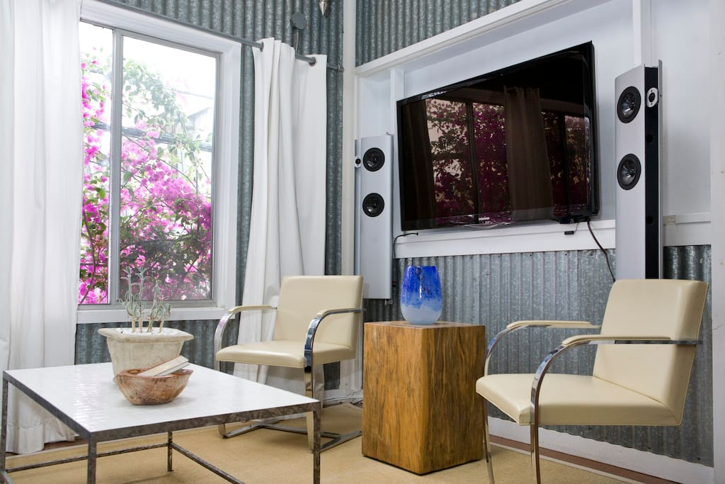 Living room with television and sound system.