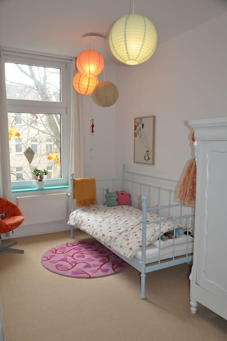 The smaller bedroom with a one person bed (adult size)