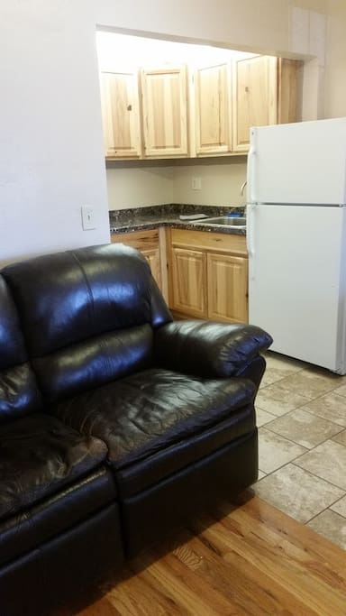 This is the living room and kitchen area.  The loveseat is a recliner and is very comfortable.