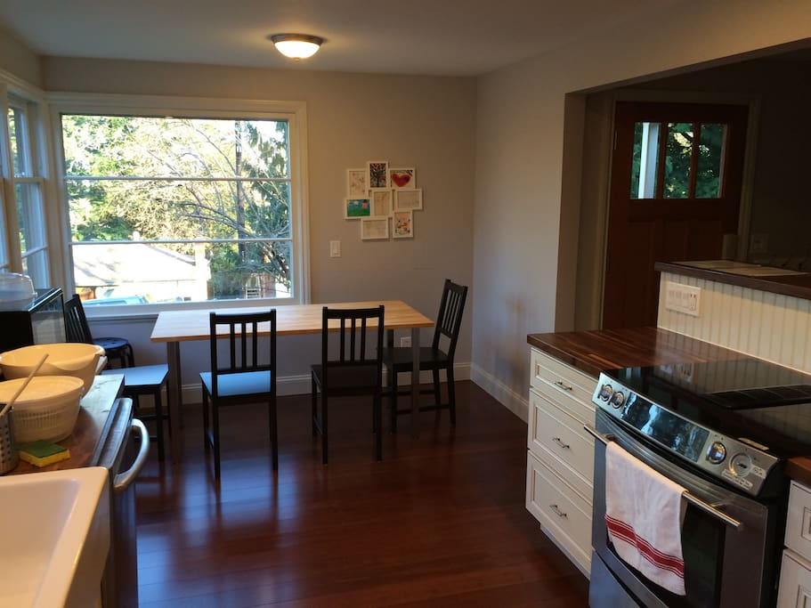 Kitchen is spacious and well lit. Dining area fits 6 comfortably and 8 in a pinch.
