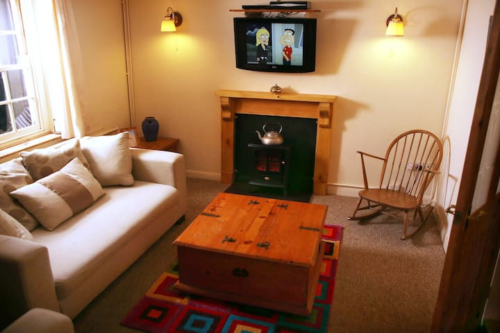 The living room, equipped with HD TV, Sky, Netflix and Apple TV, a selection DVDs and a selection of books and games.