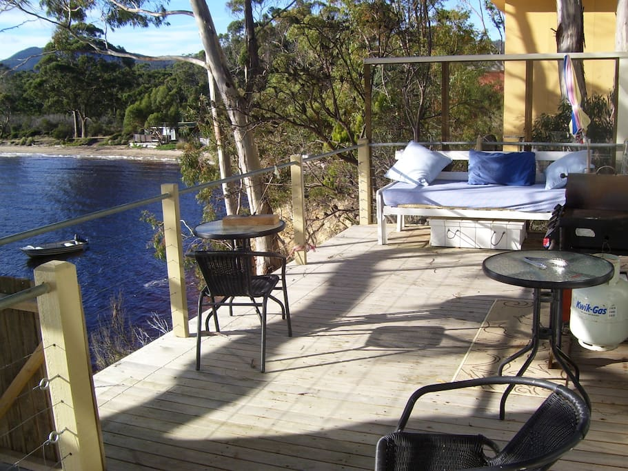 Relax and enjoy the tranquility of this sunny northernly, private deck, staircase lead to pristine beach.
