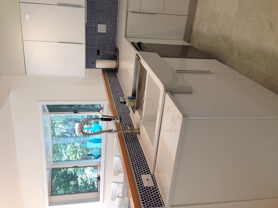 Another view of the fully-stocked kitchen.