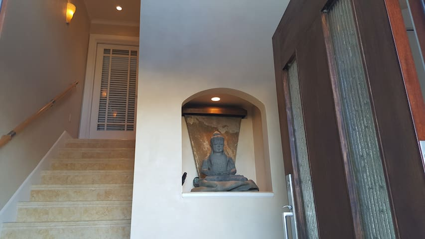 Front door brings you to beautiful foyer with marble stairs up to your door.
