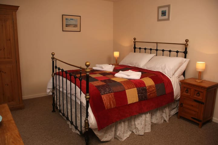 The main bedroom at Juanperi features a genuine Victorian bedstead.