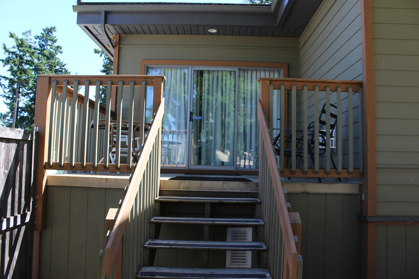 Stairs leading up to deck and door