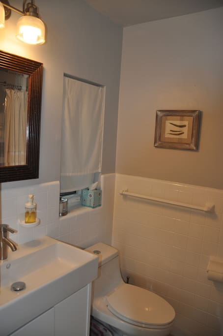 Your small private bathroom with window and good light at the mirror