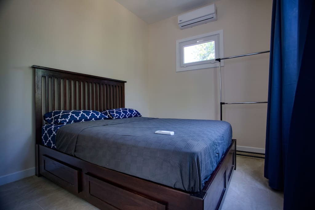 Queen size bed, with storage, air conditioner, large window, patio