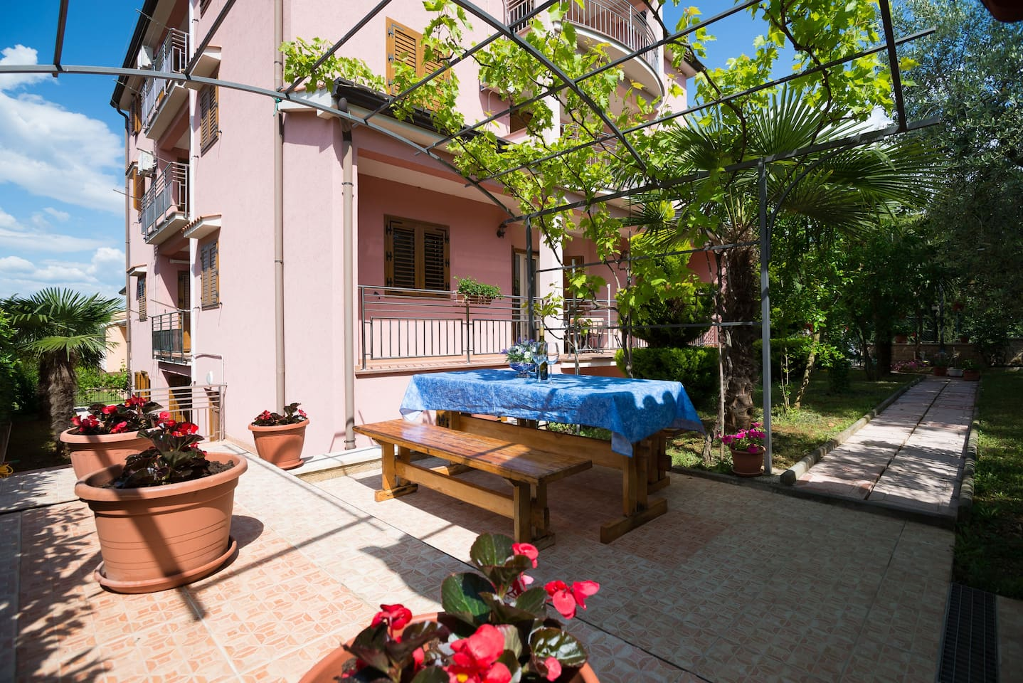 Terrace in the garden with barbecue facilities and garden furniture