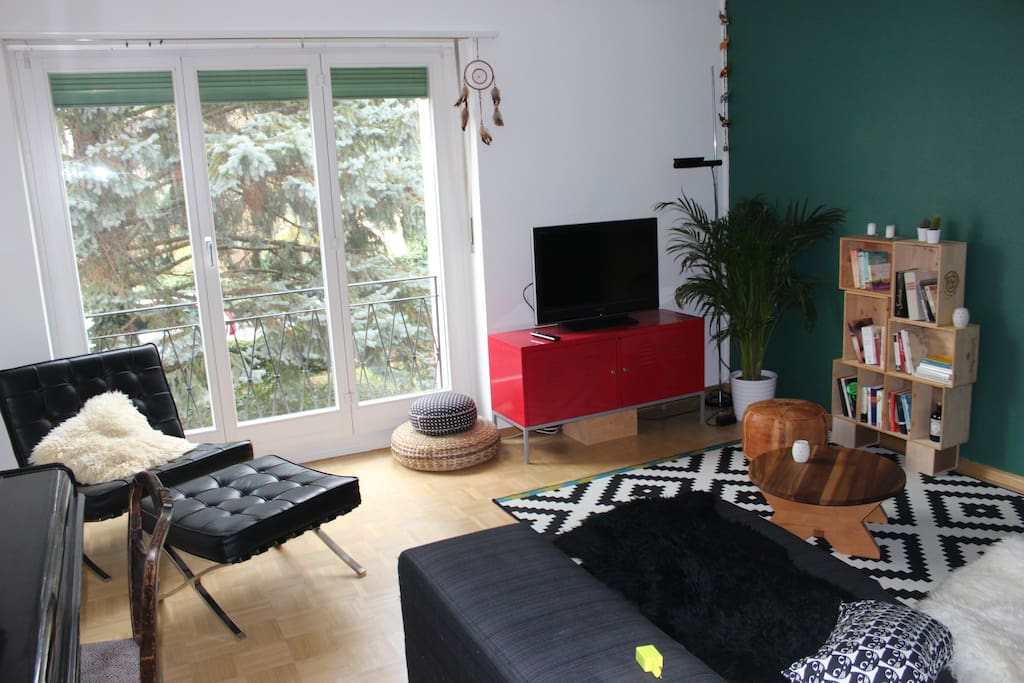 cozy living room with sofa, TV and a piano