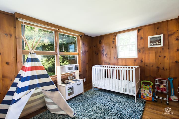 Child's bedroom with a crib and an air mattress available.
