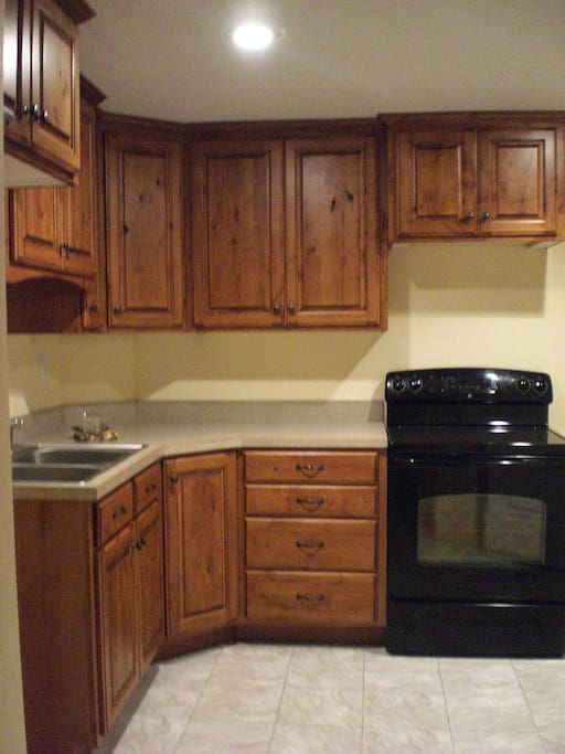 Kitchen. Comes with microwave, stove,fridge, and cookware.