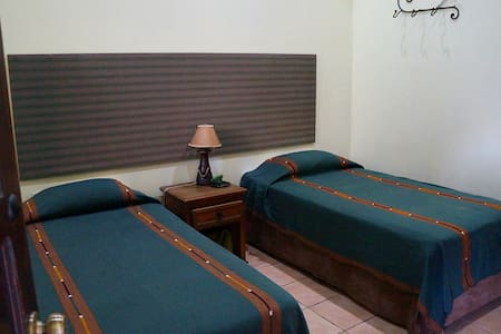 Habitación con dos camas twin