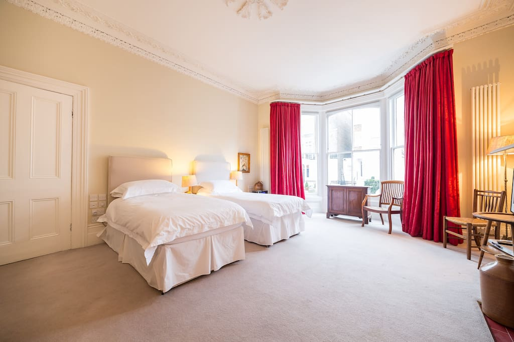 Suite 1 bedroom with two single beds. This overlooks the mature front garden.