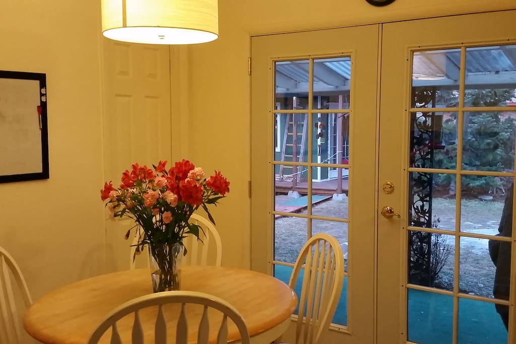 Dining area overlooks backyard and can expand to seat up to six.