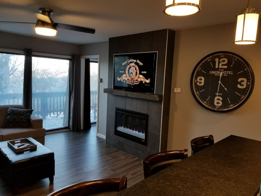 "living room fireplace with 50"" recessed tv above"