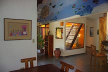 Dining Area with view into the atrium and sea mural
