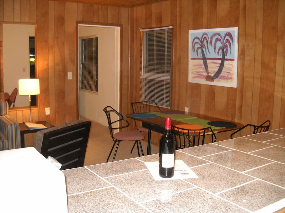 Living/dinning room space, and kitchen granite