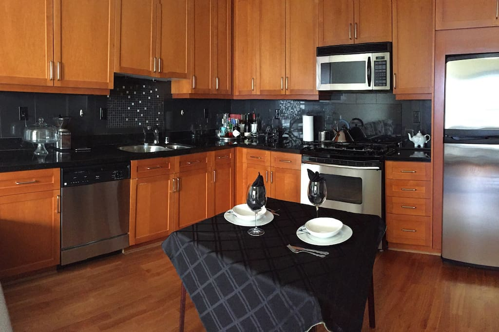 Fully equipped kitchen with dishwasher, oven, microwave, gas stove and refrigerator
