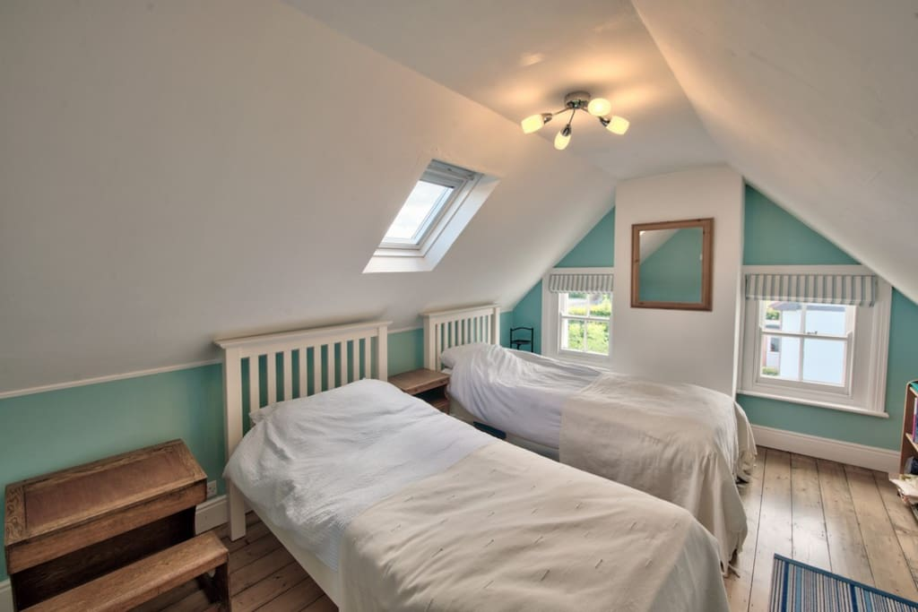 A spacious twin bedroom, recently redecorated.