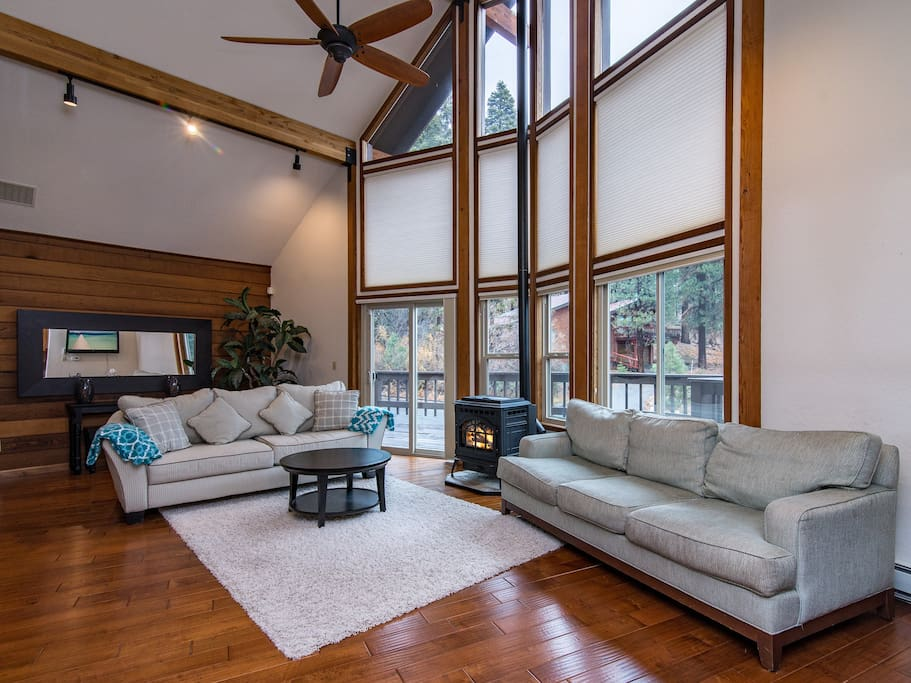 Soaring ceilings and large windows create an airy ambiance in the living room. Home is professionally cleaned by TurnKey housekeeping staff.
