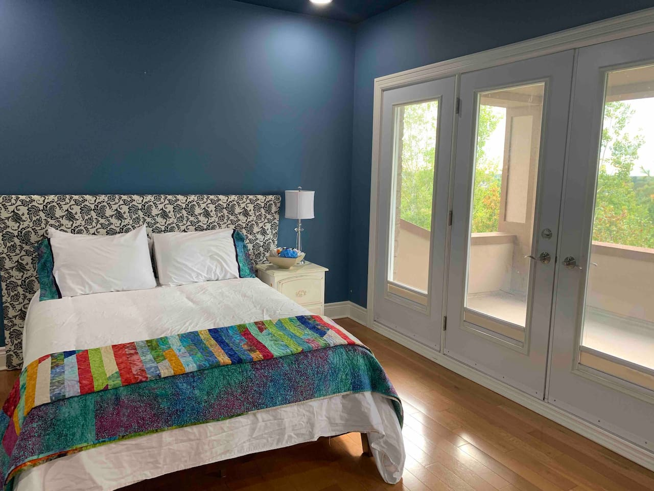 This bedroom has a queen bed and access to terrace that is shared between the two bathrooms.