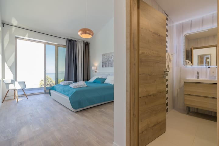 """Bedroom """"Yanko"""" with bathroom onsuite is equipped to extremely high standards, large, comfortable bed and furnishings are all of high quality. Wakeing  up with amazing sea view, pool view and having seance of perfect holiday."""