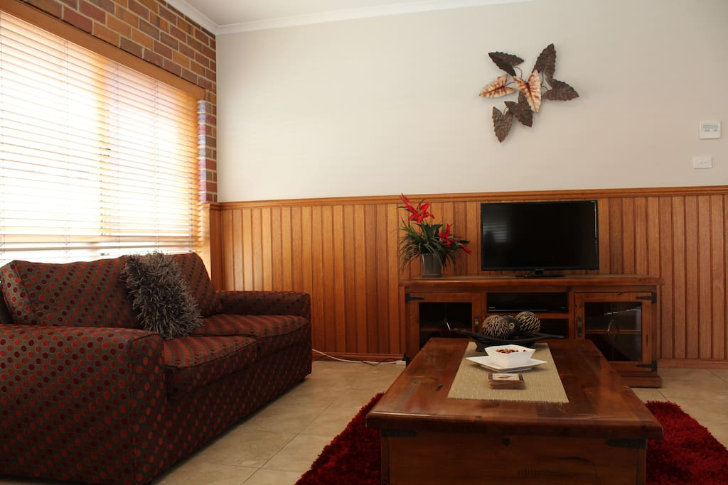 Living Area with Flat Screen T.V. DVD and Stereo/CD Player