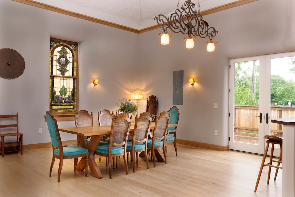 Dining area in great room. French doors lead to a large private deck.