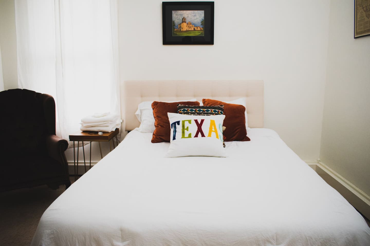 Enjoy a Queen Size Bed with Comfy Sheets and Linens.