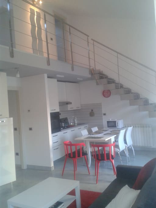 Living and dining room, stairs to the loft