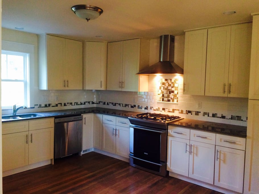 Spacious and newly renovated kitchen has everything you need to cook up a yummy meal!  If you time it right, I may cook something up for you!