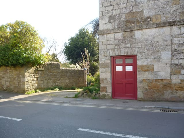Our drive entrance and the red front door which we never use