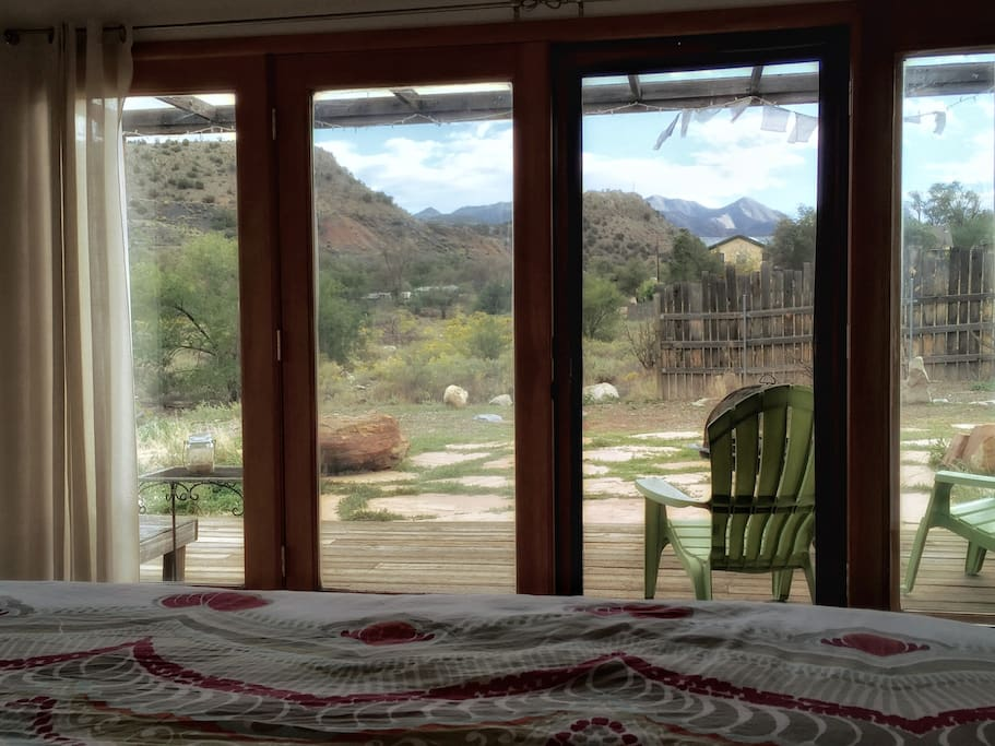 View from the bed.  These french doors open up onto the deck area!