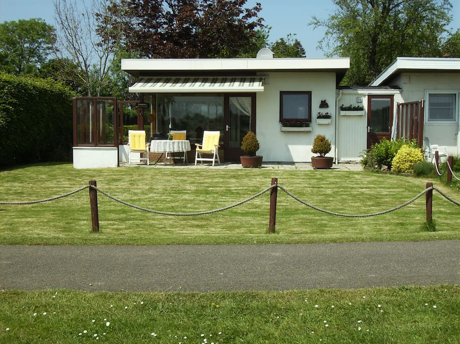 large front patio with electric awning and furniture for 5 guests
