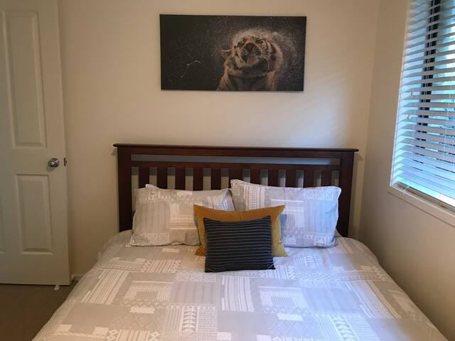Guest bedroom w ensuite in furnished elevated home