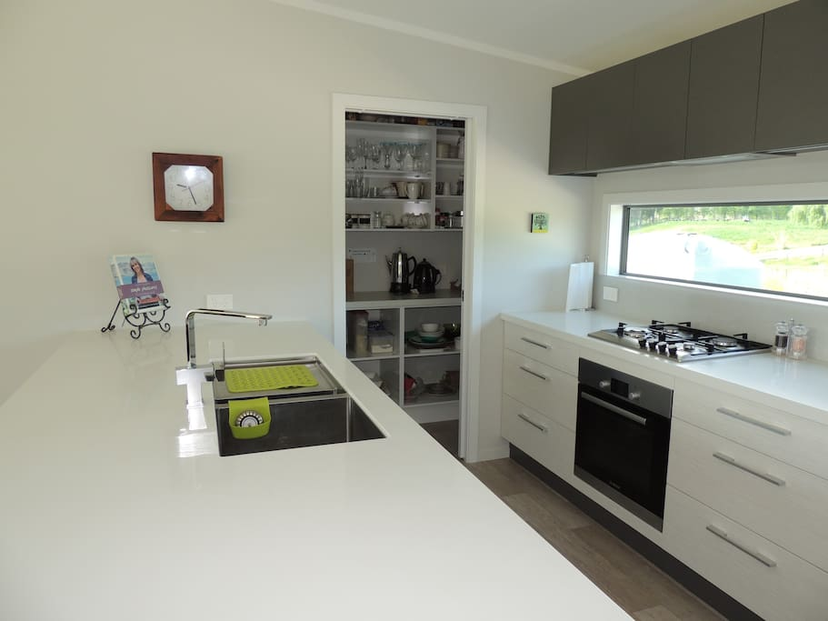 A well appointed kitchen, including dishwasher, fridge, well stocked with serving dishes, appliances, utensils...coffee, tea, milk, salt and pepper provided.