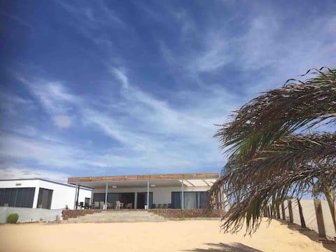 Fantástica casa em frente ao mar