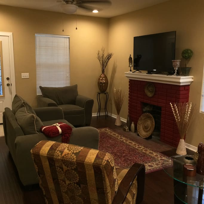 Spacious Living Room with fireplace mantel and flat screen TV