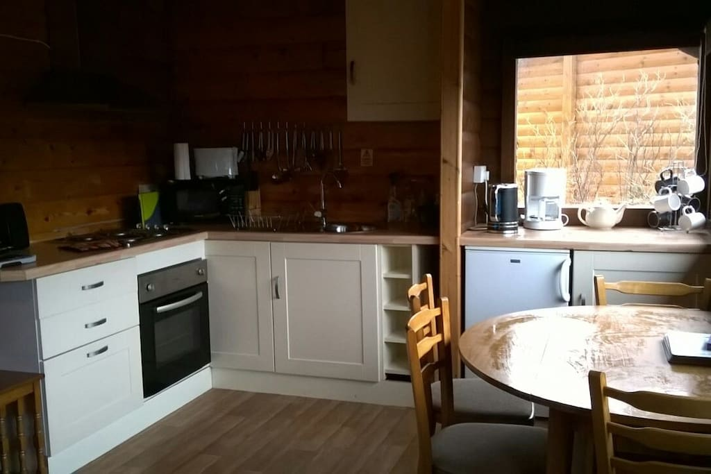 The well equipped open plan kitchen