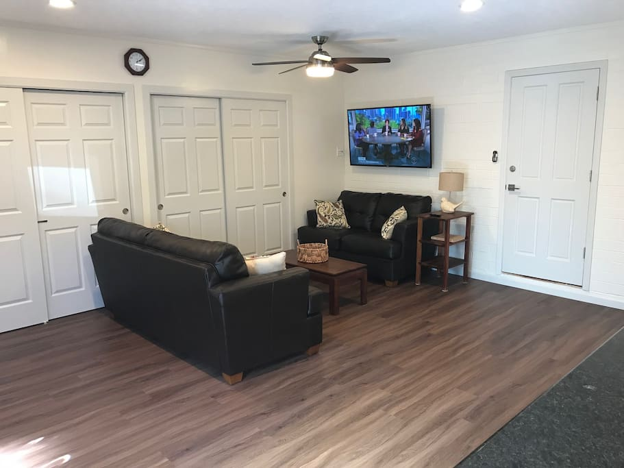 Living room with Roku TV and split AC
