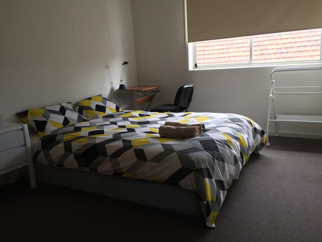 The room for you is a light filled double room with queen size bed. A small working desk is also provided.