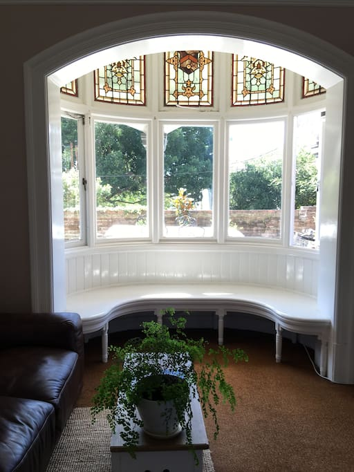 The big beautiful bay window. We have a big table to eat from and chill at outside. A stainless steel fridge.