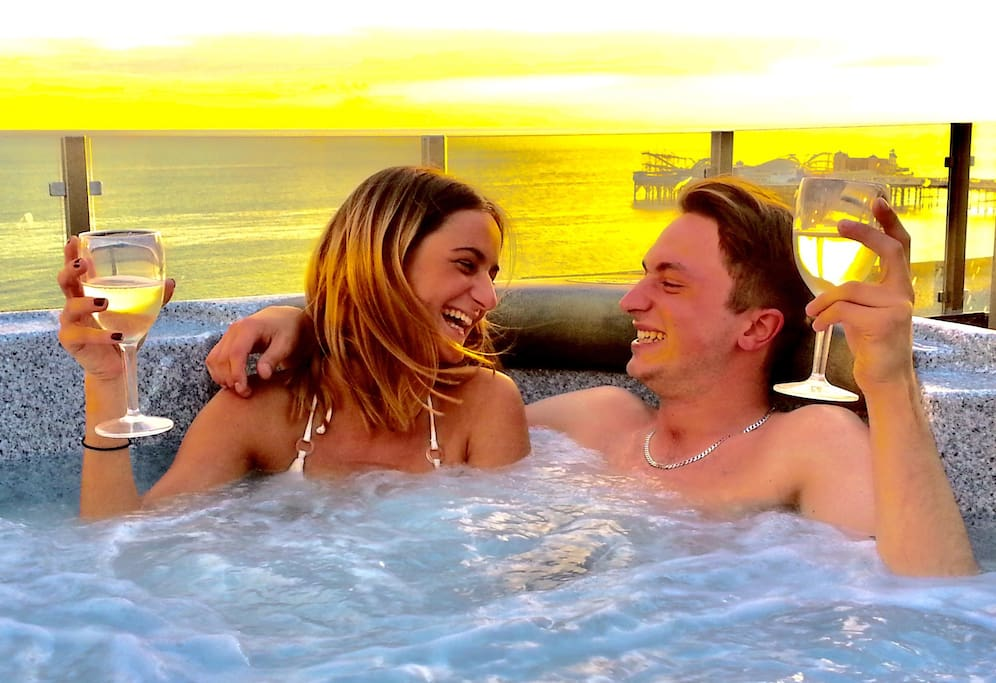 Relax and reconnect with a loved one in the huge rooftop hot tub and marvel at the stunning sea, sky and pier views.