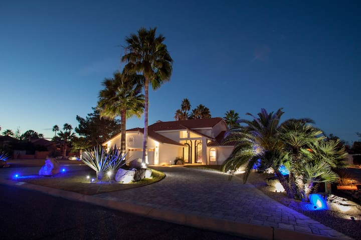 EPIC HOUSE has amazing curb appeal 24/7. Massive 2200 SQ drive way with 3 car garage,  175 LED lights around the massive property